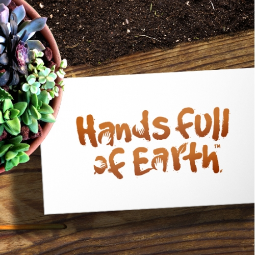 Hands full of Earth